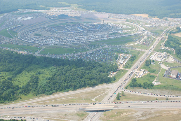 "Mileslong rows of vehicles crept along Ky. 35 and Interstate 71 on Saturday as the first Sprint Cup race at Kentucky Speedway drew traffic ""beyond what we expected,"" as one Speedway official put it."